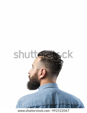 Portrait of a bearded man in a denim shirt, isolated on a white background. There is a spase for your text.