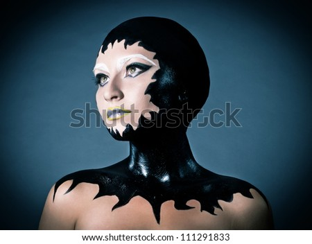 Portrait of a beautiful alien lady with original dark make up