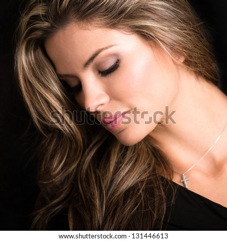 Portrait of a beautiful blond woman - isolated over black background