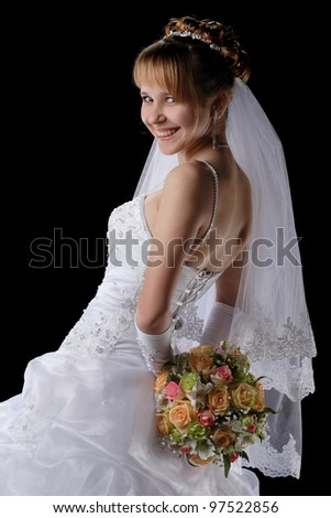 portrait of a beautiful bride with a bouquet of flowers