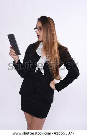 Portrait of a beautiful businesswoman with a tablet. Isolated white background.