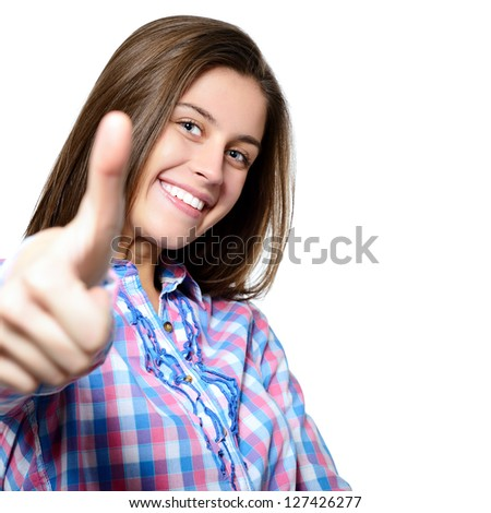 Portrait of a beautiful, confident and cheerful teenager girl showing thumbs up isolated on white