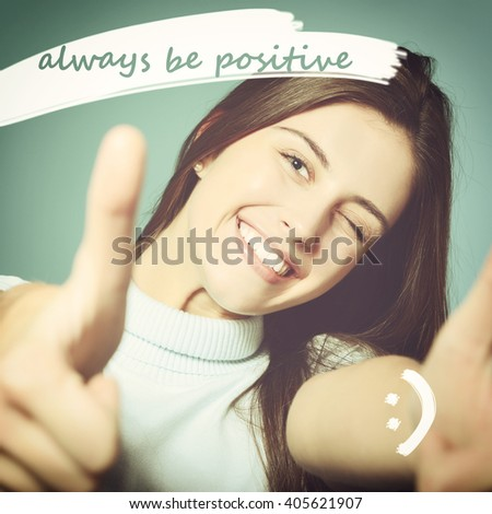 Portrait of a beautiful, confident and cheerful teenager girl showing thumbs up with positive message