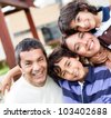 Portrait of a beautiful family looking happy - stock photo