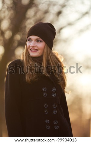 Portrait of a beautiful female model in autmn clothes outdoor.sensetive look