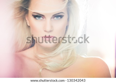 Portrait of a beautiful female model in bleached light