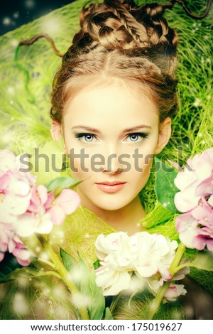 Portrait of a beautiful girl with flowers. Spring.