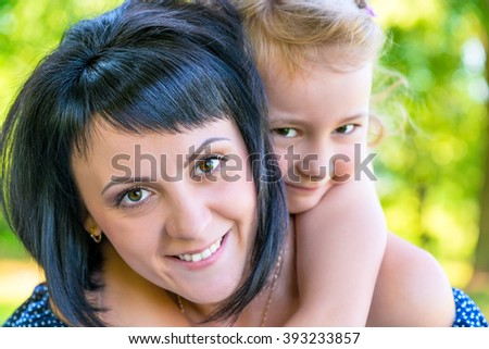 portrait of a beautiful mother and daughter close-up