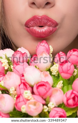 Portrait of a beautiful sexy blonde girl with flowers on a white background isolation