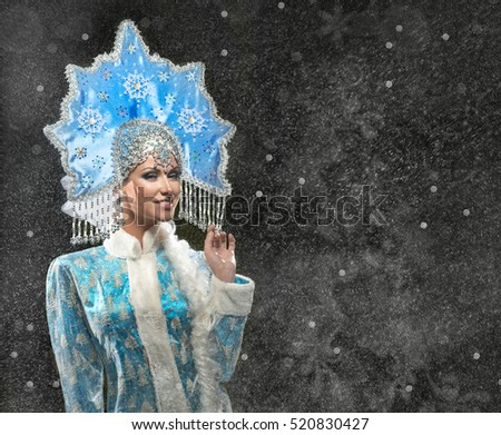 Portrait of a beautiful snow maiden in a crown on the black background