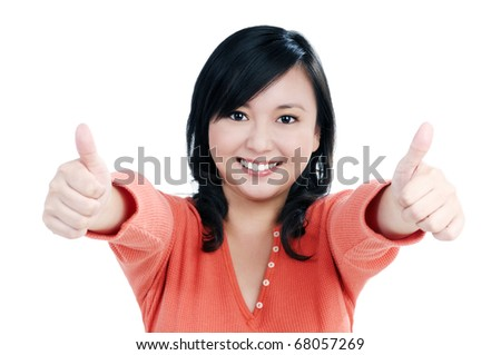 Portrait of a beautiful woman giving thumbs up sign over white background.