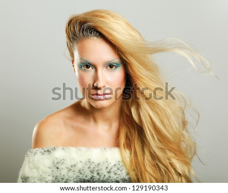 Portrait of a beautiful woman, isolated on grey  background