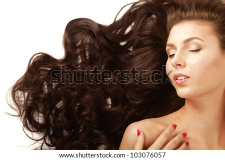 Portrait of a beautiful woman lying on the floor  isolated on white background.