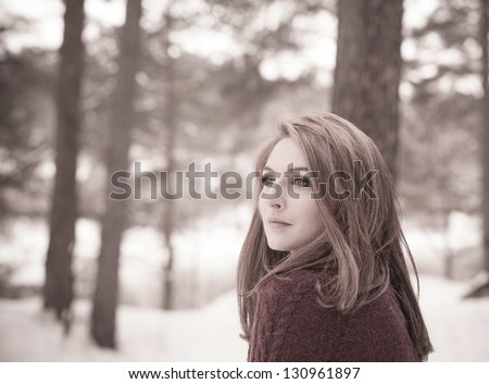 Portrait of a beautiful woman on winter park