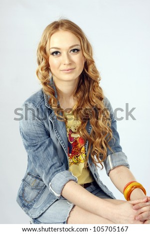 Portrait of a beautiful woman wearing denim shorts and a jacket