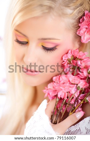 Portrait of a beautiful woman with blossoms, spring