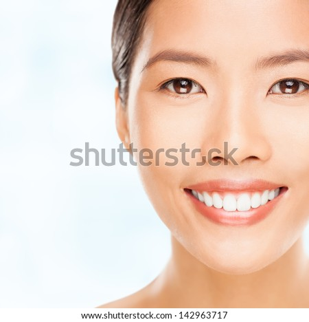 Portrait of a beautiful young Asian woman smiling.