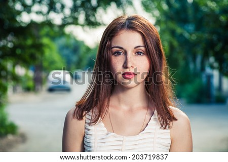 Portrait of a beautiful young girl head and shoulders.