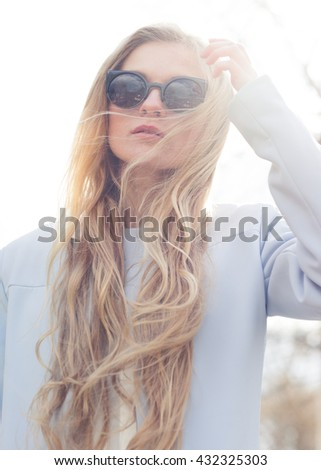 portrait of a beautiful young girl in sunglasses
