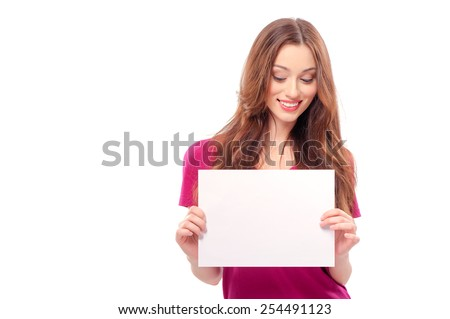 Portrait of a beautiful young woman holding a blank billboard, looking out from behind it. beautiful woman and blank sign
