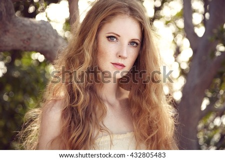 Portrait of a beautiful young woman in summer garden. Girl on nature. Spring mood.  Fashion beauty