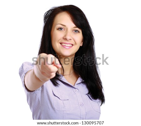 Portrait of a beautiful young woman pointing at you, isolated on white background