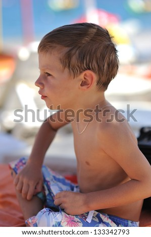 portrait of a boy in profile on a hot afternoon in nature