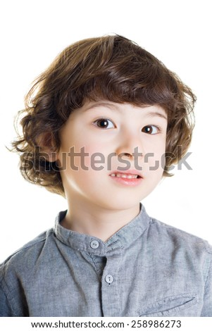 Portrait of a boy with a painful look. White background.