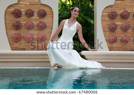 Portrait of a bride by the swimming pool.