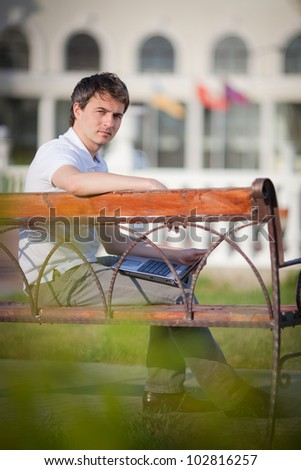 Portrait of a businessman working on a bench
