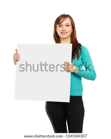 Portrait of a casual young woman holding blank card - over white background.