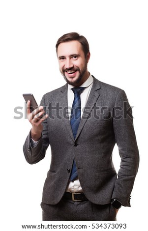 Portrait of a cheerful businessman talking on the phone isolated