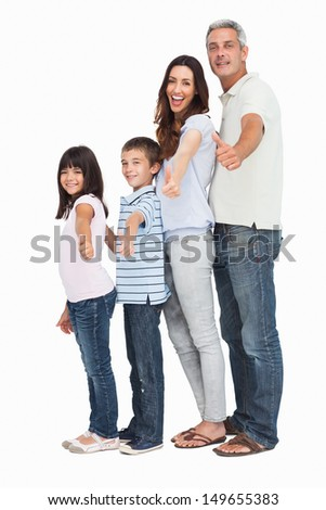 Portrait of a cute family in single file doing thumbs up at camera on white background
