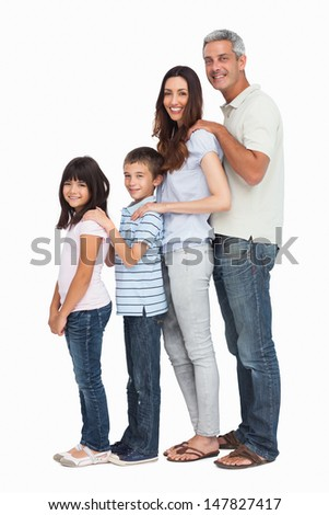 Portrait of a cute family in single file on white background
