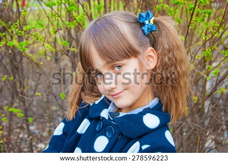 Portrait of a cute little girl with big gray eyes
