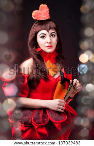 portrait of a cute queen of hearts on the black background
