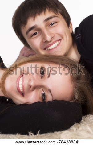 portrait of a cute young couple lying on the carpet