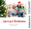 Portrait of a family at Christmas on the sofa against merry christmas - stock photo