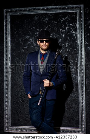 Portrait of a fashionable male model wearing elegant suit. Studio shot.