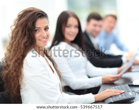 portrait of a female accountant in the workplace in front of com