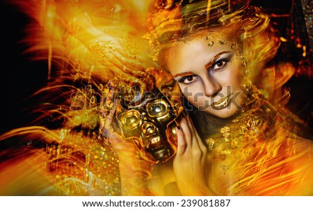 Portrait of a girl with a fiery golden make-up shot using the technique of mixed light
