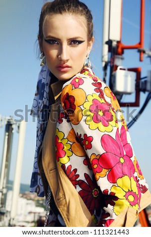 portrait of a girl with fashion makeup, dressed in colorful, floral jacket