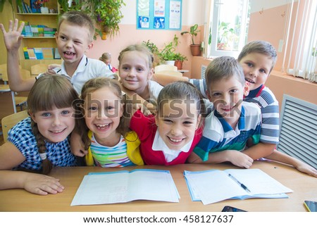portrait of a group of primary school children in a class at their desks
