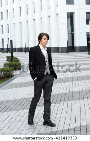 Portrait of a handsome business man at the office building outside
