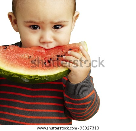 portrait of a handsome kid holding a watermelon and sucking over white background