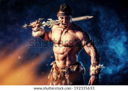 Portrait of a handsome muscular ancient warrior with a sword.