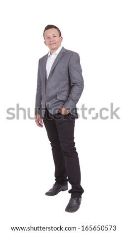 Portrait of a handsome young businessman posing with hands in pocket against white background