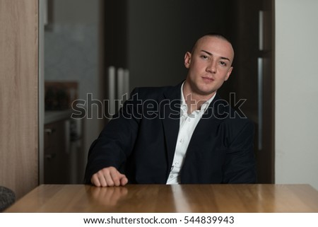 Portrait of a Handsome Young Man in Suit and Tie Resting at Home