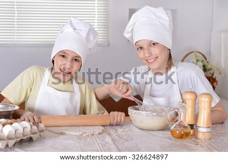 Portrait of a happy boys cooking together