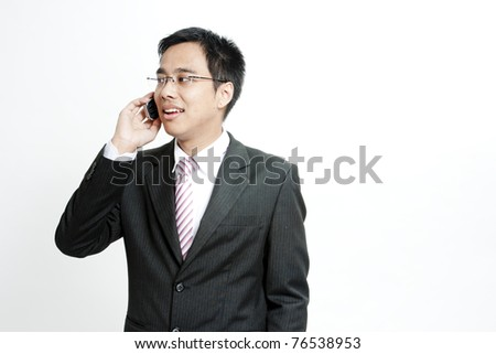 Portrait of a happy business entrepreneur talking on cellphone